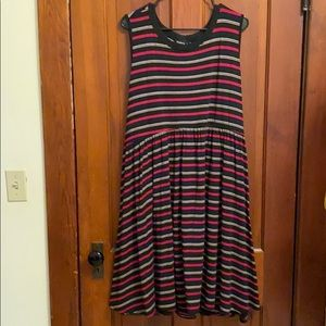 Sleeveless striped dress with cutout back detail.
